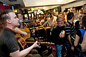 Singers and visitors in an Irish pub, Fleet Street, Temple Bar area, Dublin, County Dublin, Ireland