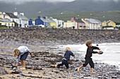 Childeren playing on the shore, Ballybrack, Ballinskelligs Bay, Iveragh Peninsula, Ring of Kerry, County Kerry, Ireland