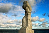 Große Stehende, The big standing, sculpture of a mourning sailors wife by Werner Stoetzer along the Mole quai, Rostock-Warnemuende, Mecklenburg-Western Pomerania, Germany