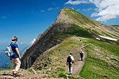 Hikers on the way to the Faulhorn peak, Bernese Oberland Switzerland