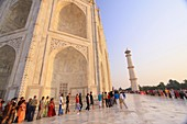 Tourists wait in line on the marble floor to enter the inside of the Taj Mahal, Agra, India