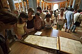The Archabbey Saint Martin, Pannonhalma, Hungary, is listed as UNESCO world heritage  Library with visitors looking at an old manuscript  Europe, Eastern Europe, Hungary, Pannonhalma, August 2009