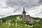 The wooden church biserica de lemn of Botiza, maramures, Romania is listed as the UNESCO World heritage  It was built in 1694 completely from wood and is an example of the traditional crafts in maramures  Europe, Eastern Europe, Romania, Maramures, Jun