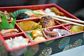 Detail of Japanese Bento food box containing many different varieties of cuisine