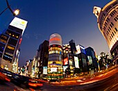 Evening fish-eye view of street intersection at night at Ginza in Tokyo