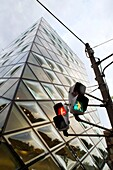 Abstract view of trafic lights and futuristic glass walled Prada boutique in Tokyo Japan