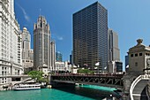 Downtown Chicago city scene with tour boat and bridge