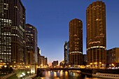 Dusk scene of Chicago skyline with Marina Towers along river