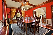 Traditional dining room in suburban home with red walls
