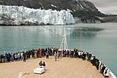 Passengers on cruise ship viewing the glaciers, Glacier Bay National Park, Inside Passage, Alaska, USA