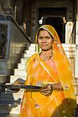 Female worshipper holding offering tray, at Sachiya Mata Temple, Osian, near Jodhpur, Rajasthan, India