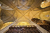 Gothic cross vault and organ on the right, cathedral of Seville. Andalusia, Spain