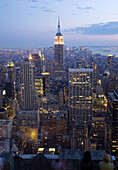 Sunset view of Empire State Building and New York City, USA