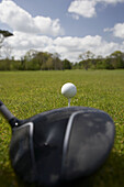 used golf ball sitting on the tee with driver club behind at the start of a golf course county armagh northern ireland