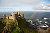 dunluce castle with rainbow and the north antrim coastline county antrim northern ireland uk