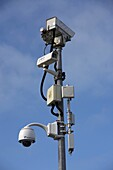 mast with various security cameras against blue cloudy sky in ballycastle county antrim