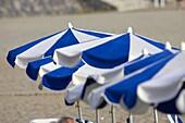 blue and white beach umbrellas on playa de las americas Tenerife Canary Islands Spain