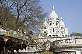 France, Paris 75  Basilique du Sacré-Coeur in Montmartre, with merry-go-round in the foreground