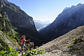 Woman ascending to Triglav, Vrata valley, Triglav National Park, Julian Alps, Slovenia