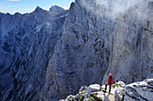 Woman standing at cliff, Vrata valley, Triglav National Park, Julian Alps, Slovenia