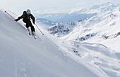 Woman downhill skiing in powder snow, Parsenn, Davos, Canton of Grisons, Switzerland