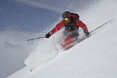 Skier in deep powder snow, Parsenn, Davos, Canton of Grisons, Switzerland