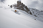 Downhill skiing in deep powder snow, Arosa, Canton of Grisons, Switzerland