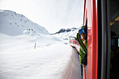 Skier looking out of train, Disentis, Oberalp pass, Canton of Grisons, Switzerland