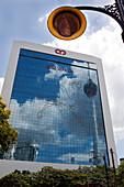 Menara Tower mirrored in the facade of a business building, Kuala Lumpur, Malaysia, Asia