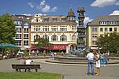 Well with column telling history, Josef-Görres-Platz, (Josef-Görres-Square) Koblenz, Mosel, Rhine, Rhineland-Palatinate, Germany, Europe