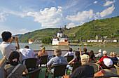 People on deck, Gutenfels castle, Pfalzgrafenstein castle, Kaub, Shipping on the river Rhine, Köln-Düsseldorfer, Mittelrhein, Rhineland-Palatinate, Germany, Europe