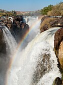 Namibia - At the beautiful Epupa Falls the Kunene River border river between Namibia and Angola drops in a series of cascades into a 60m deep gorge Kaokoland, Kunene region, Namibia