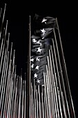 38 huge black flags bearing a white star in front of the U S diplomatic mission in Havana to mourn for the victims of the 1961 Bay of Pigs invasion. El Malecón. Havana. Cuba.