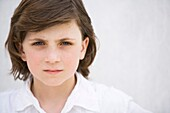 blue eyes, boy, brown hair, Caucasian ethnicity, chestnut hair, child, clipping path, Close-up, Color image, contemporary, face, headshot, horizontal, human, kid, looking at camera, Male, one, one person, people, portrait, pre-teen, serious, seriousness,