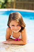 bikini, border, brown hair, Caucasian ethnicity, chestnut hair, child, childhood, Color image, contemporary, day, edge, Female, girl, happiness, happy, head and shoulders, headshot, holiday, human, infancy, innocence, innocent, joy, kid, lean, leaning, le