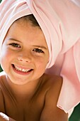 Pretty girl with a towel around her head