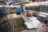 Finland, Helsinki, Helsinki Automobile Museum, model car exhibit and 1950s-era Messerschmitt Kabinenroller car