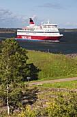 Finland, Helsinki, Suomenlinna-Sveaborg Fortress, international ferry passing by Kustaanmiekka