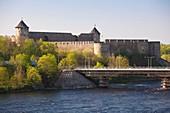 Estonia, Northeastern Estonia, Narva, view of Narva River, Friendship Bridge and Ivangorod Castle, Russia, morning