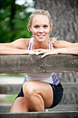 30 year old blonde woman in work out clothes smiling at camera