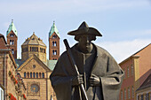 Sculpture of a pilgrim in Maximilianstraße and Speyer cathedral, Rhineland-Palatinate, Germany, Europe