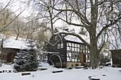 Idyllic snow covered watermill in a winter landscape, Haunetal, Rhoen, Hesse, Germany, Europe