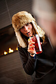 Woman with a drink in Cypress Creek Day Lodge, Cypress Provincial Park, British Columbia, Canada