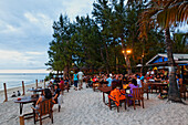 People in one of Saint Gilles beach bars in the evening, La Reunion, Indian Ocean