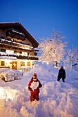 Mother with daughter in snow, Hotel Chesa Valisa, Hirschegg, Kleinwalsertal, Vorarlberg, Austria