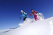 Young women snowshoeing, Hemmersuppenalm, Reit im Winkl, Chiemgau, Upper Bavaria, Bavaria, Germany, Europe
