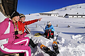 People having a rest after snowshoeing, Eggenalm, Reit im Winkl, Chiemgau, Upper Bavaria, Bavaria, Germany, Europe