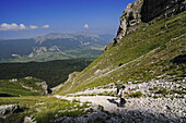 Hiker at ascent through Rava del Ferro at Monte Amaro, Caramanico Terme, Maiella Mational Park, Abruzzi, Italy, Europe