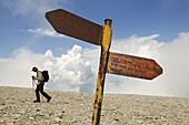 Hiker at summit plateau of Monte Amaro, Caramanico Terme, Maiella National Park, Abruzzi, Italy, Europe