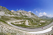 Cyclist on country road at Campo Imperatore, Gran Sasso National Park, Abruzzi, Italy, Europe